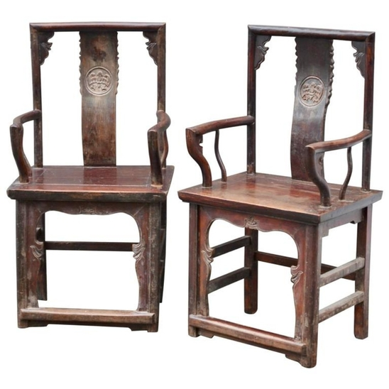 Pair of armchairs in carved elm.  Qing dynasty, China